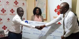 THANK YOU- Fred Migadde receives his cheque from AAR Insurance towards the treatment of his daughters medical bills in India