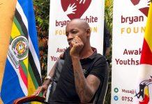 Bryan White addressing the press at his palatial home in Munyonyo