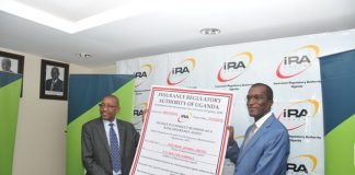 IRA Chief Executive Officer, Alhaj Kaddunabbi Ibrahim Lubega handing over the license to KCB Bank