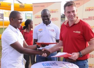 NBL Country Director Thomas Kamphuis shakes hands with Daniel Nsumba, of Designate drivers after signing a partnership for the Smart Drinking Campaign