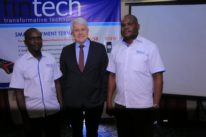 (L-R) Fintech's Infrastracture and Services manager George Ondego, CEO Fintech Group, Barry Ryan and Vincent Ondiff, the Regional Manager while at the do