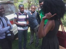 Maggie explaining to journalists why she was at court