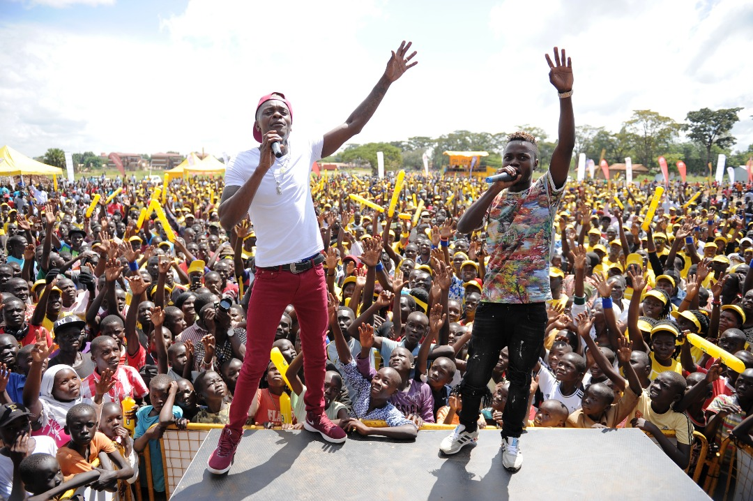 Singer Jose Chameleone entertaining runners at the marathon