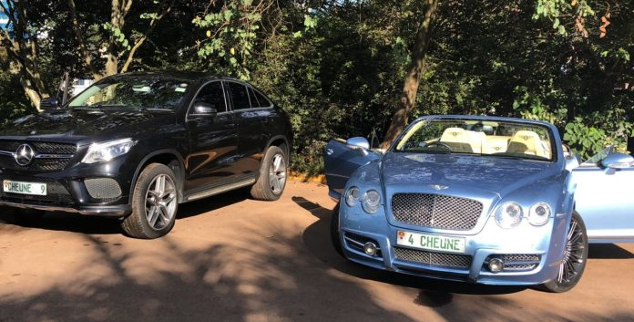 Cheune's black mercedes parked at Serena besides his Bentley