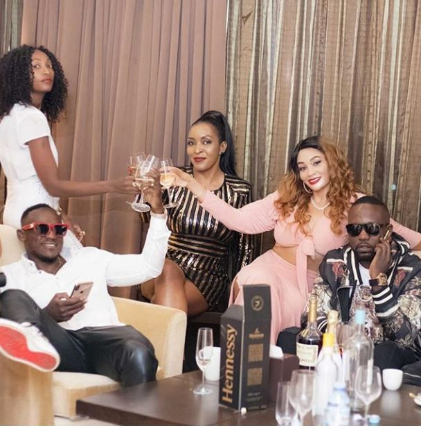 Zari popping bottles with the Rich gang