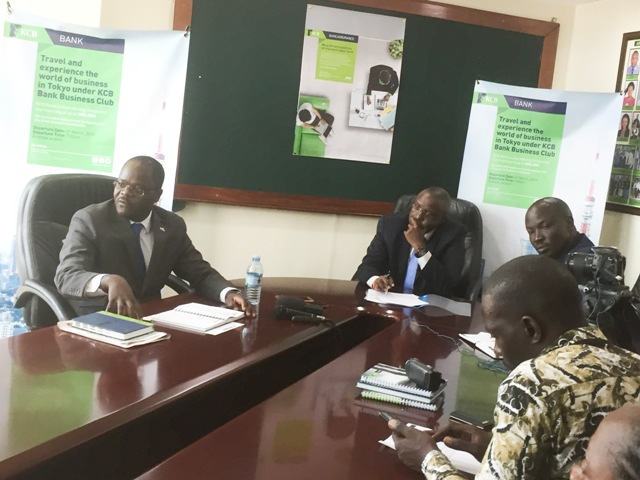 L-R Godfrey Ssenteza, KCB's senior manager SME, MD Edgar Byamah and Samuel Matekha address journalists during the launch of KCB's Trip to Tokyo