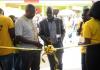 Arua Municipality Mayor Al-Hajj Issa Kato officially marking the launch of Momopay in West Nile