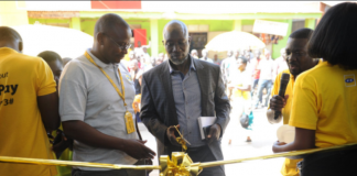 Arua Municipality Mayor Al-Hajj Issa Kato officially marking the launch of Momopay in West Nile