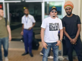 Talent Africa's Aly Alibhai with Chronixx at Entebbe Airport yesterday