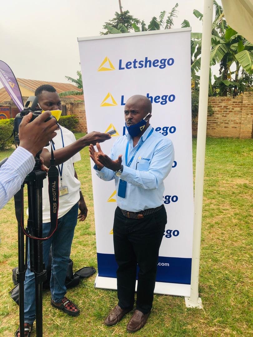 Roger Mugisha Corporate Communications Manager Letshego addressing the media after handing over the COVID relief contribution.
