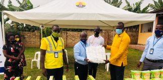 Roger Mugisha Corporate Communications Manager Letshego hands over items worth UGX4M to Hon Haruna Kyeyune Kasolo MP of Kyotera as a COVID relief contribution.