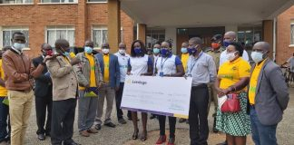 Bushenyi district CAO Mahabba Malik (with microphone) applauds the team from Letshego Uganda led by Joseph Kimbugwe (Head of MSE) during the UGX5M support to the Bushenyi Covid-19 Task Force handover in Bushenyi last weekend