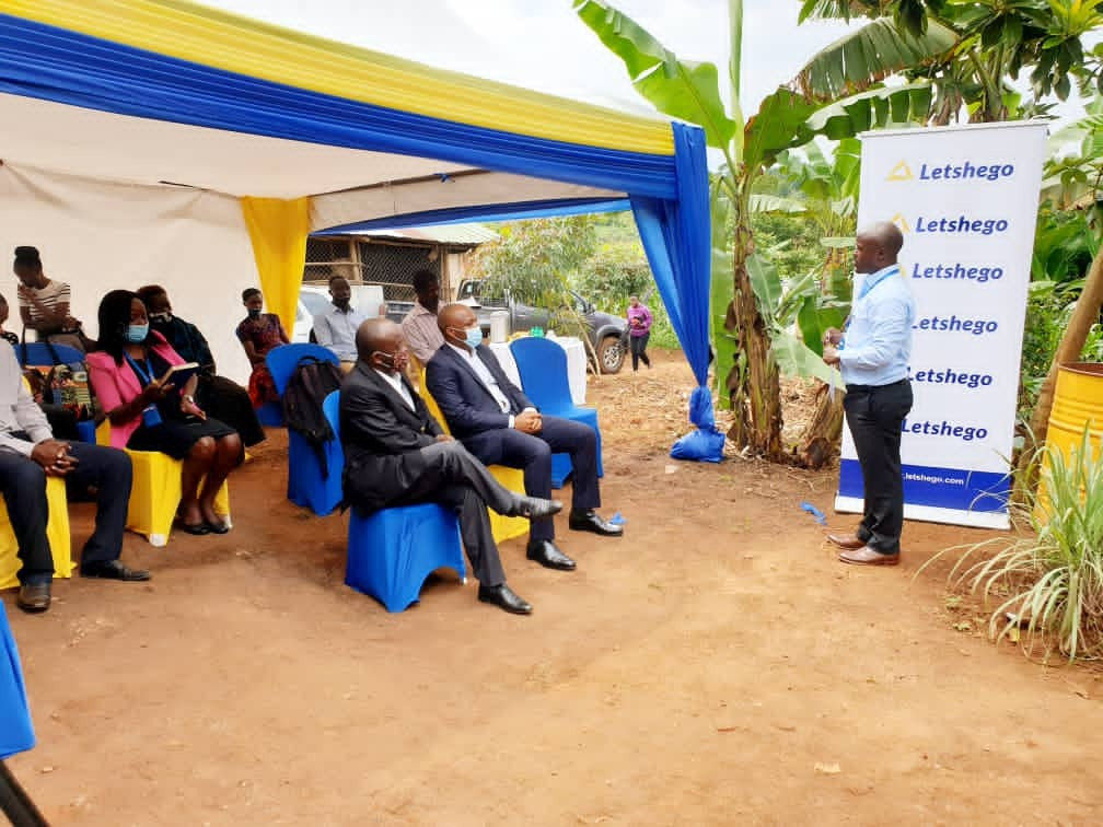 Roger Mugisha (Head Corporate Communications) speaks to Letshego directors Peter Masaba, CEO Aijukwe Giles and the farmers during the official handover of ILC Poultry project in Wakiso yesterday