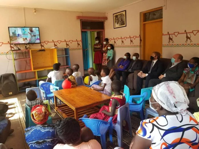 Team from British High Commission and parents of Cancer patients watch video clip on Bless A Child Foundation.